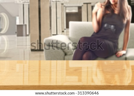 woman in black dress and sofa in room with yellow glasses desk top