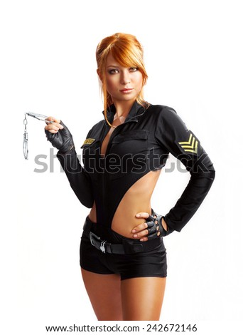 Woman in black dress holding handcuffs - stock photo