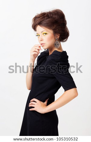 Woman in black dress isolated on white
