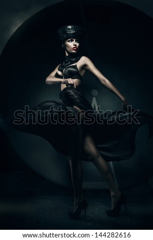 woman in black hat and hourglass - stock photo