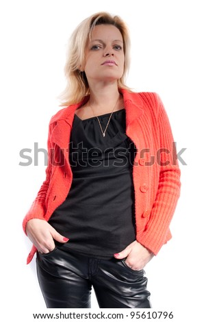Woman in black leather pants and red jacket
