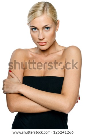 Woman in black top embrace herself and shiver with cold over white - stock photo