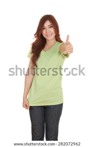 woman in blank green t-shirt with thumbs up isolated on white background - stock photo