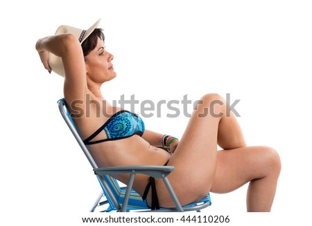 Woman in blue bikini sitting in a chair