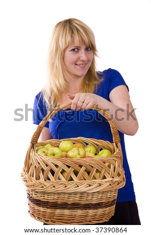 Woman in blue blouse standing and holding a basket full apples on white background. Beautiful girl holding a basket of delicious fresh fruits. Isolated over white. - stock photo