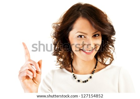 Woman in business uniform point over her head with big smile - stock photo