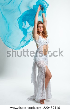 woman in carnival costume on white, belly dance