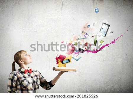 Woman in casual wear holding opened book in hands - stock photo