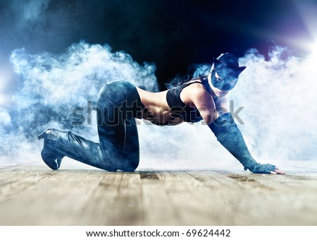 Woman in cat suit with smoke effect. - stock photo