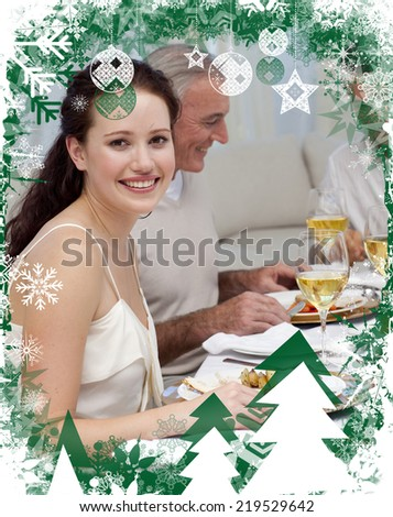 Woman in Christmas dinner with her family against christmas themed frame - stock photo