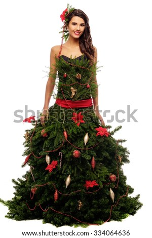 Woman in christmas tree dress isolated on white - stock photo