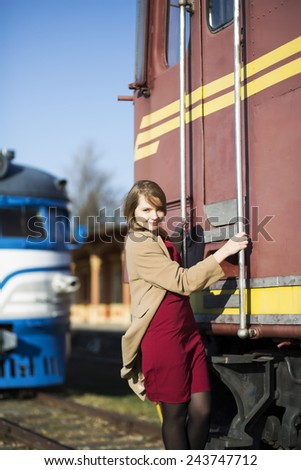 Woman in coat and wagon at sunny day - stock photo