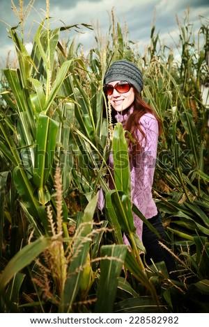 Woman in corn maze - stock photo