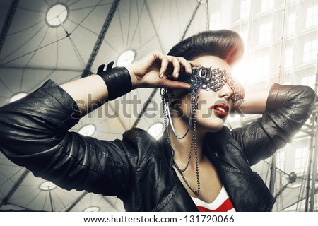 woman in creative sunglasses and architecture - stock photo