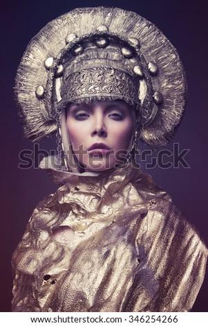 Woman in decorative  head wear - stock photo