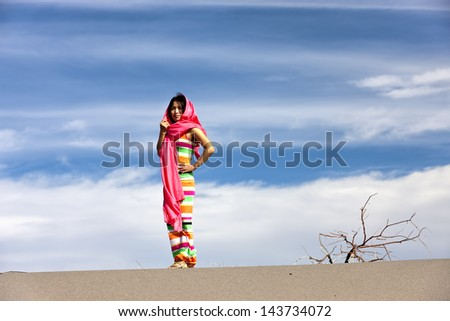 Woman in desert. - stock photo