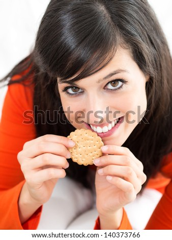 Woman in diet holding whole wheat cracker and smiling before eating. Healthy eating and nutrition. - stock photo