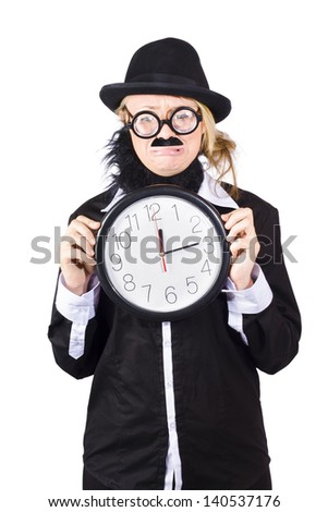 Woman in disguise wearing bowler hat, false beard and mustache  with wide rimmed glasses holding large clock at ten past twelve - stock photo