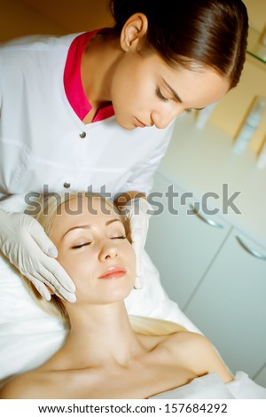 Woman in doctor's office beautician or beauty salon - stock photo