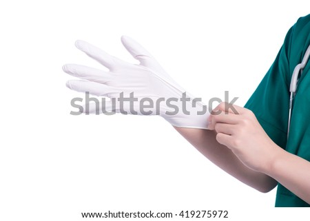 Woman in doctor uniform wearing latex gloves - stock photo