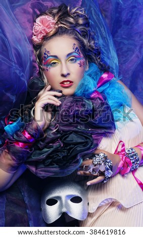 Woman in doll style with mask. Carnaval pictures. - stock photo