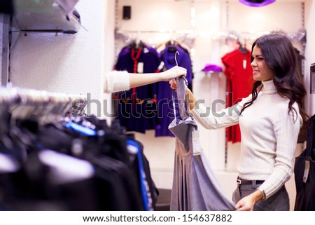 woman in dress room wear dress