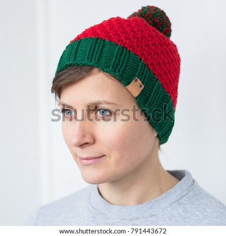 Woman in Elf red-green hat