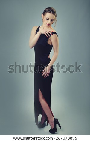 woman in evening dress with beautiful hairstyle
