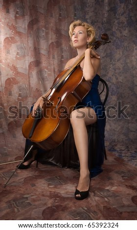 woman in evening dress with old cello - stock photo