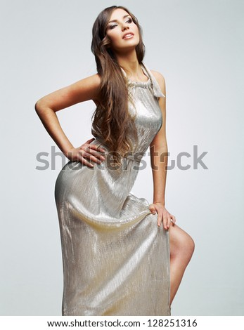 woman in evening dress . young model with long hair studio posing - stock photo