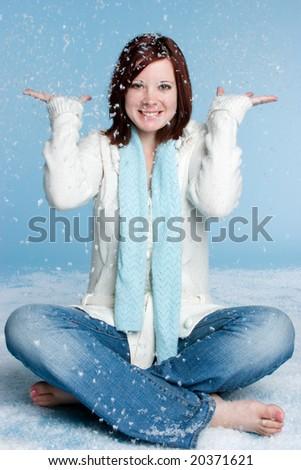 Woman in Falling Snow - stock photo