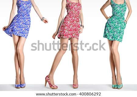 Woman in fashion vintage dress and high heels. Female sexy long legs, stylish colorful flower sundress and summer shoes. Girl in various playful poses. Unusual creative walking out outfit, people - stock photo