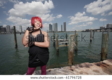 Woman in fashionable clothing by the bay - stock photo