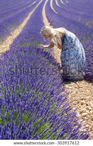 Woman in floral field of lavender