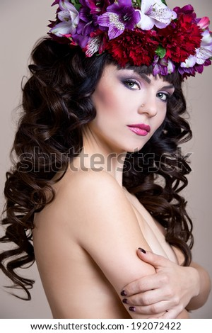 Woman in flower wreath - stock photo