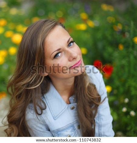 woman in flowers outdoor - stock photo