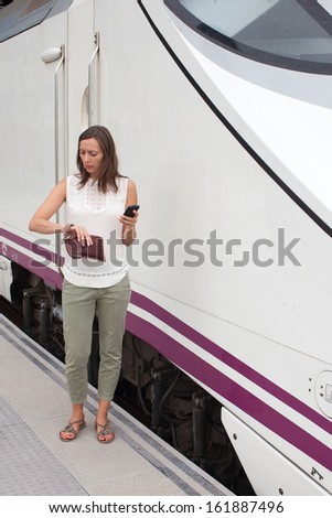 Woman in front of train waiting