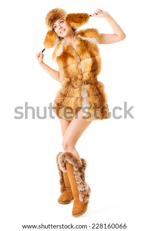 Woman in fur coat. Winter fashion. White isolated background - stock photo