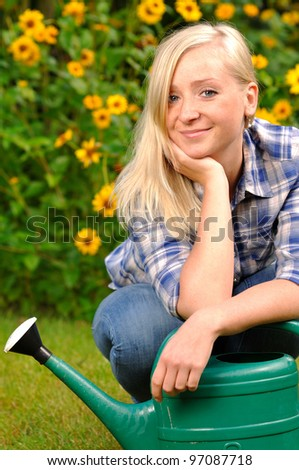 Woman in garden. - stock photo