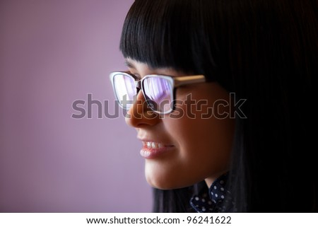 woman in glasses with flares close up - stock photo