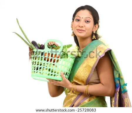 Woman in green silk-sari with lots of vegetables