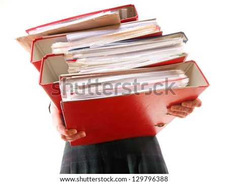 woman in grey holding stack of folders. Pile with old documents and bills. Isolated on white background