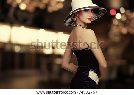 Woman in hat over blurred background. - stock photo