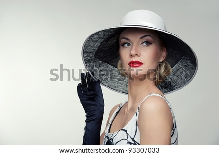 Woman in hat retro portrait.