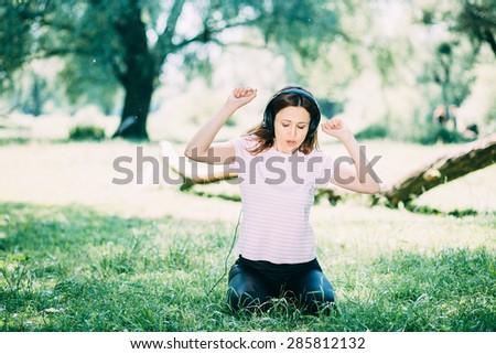 Woman in headphones - stock photo