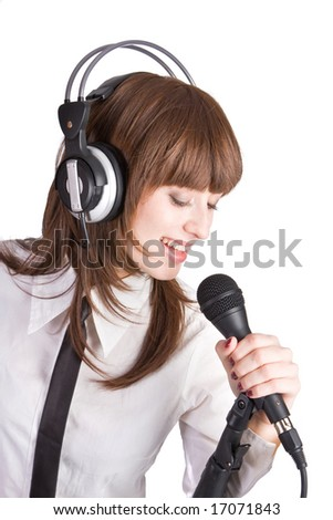 Woman in headphones Singing into Microphone