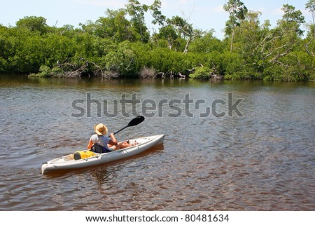 Woman In Kayak Darling Wildlife Refuge Sanibel Florida - stock photo