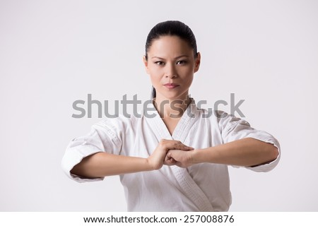 Woman in kimono going for greeting on white - stock photo