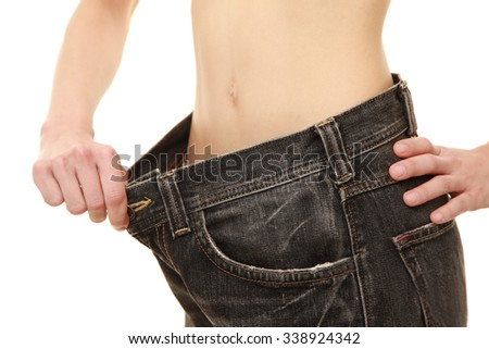 woman in large pant after losing weight - stock photo