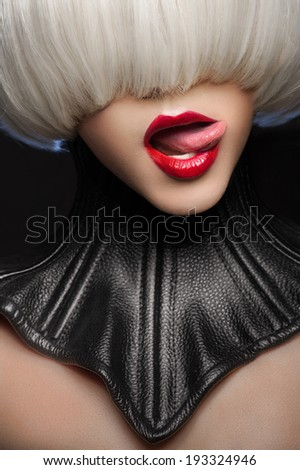 Woman in leather neck corset with modern haircut